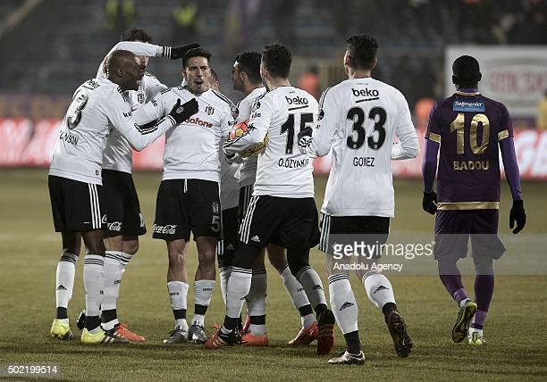 Players of Besiktas celebrate after Jose Sosa scored a goal during the Turkish Spor Toto Super Lig match between Osmanlispor and Besiktas at the...