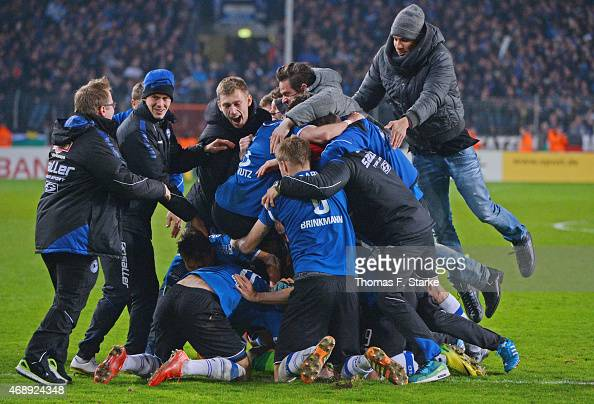 Players of Bielefeld celebrate after winning the DFB Cup match between Arminia Bielefeld and Borussia Moenchengladbach at Schueco Arena on April 8...