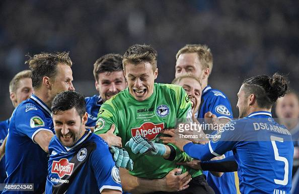 players of Bielefeld celebrate with goalkeeper Alexander Schwolow after winning the DFB Cup match between Arminia Bielefeld and Borussia...