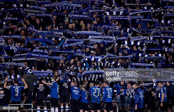 Players of Bielefeld celebrate with their fans after winning the round of 16 DFB Cup match between Arminia Bielefeld and Werder Bremen on March 4...