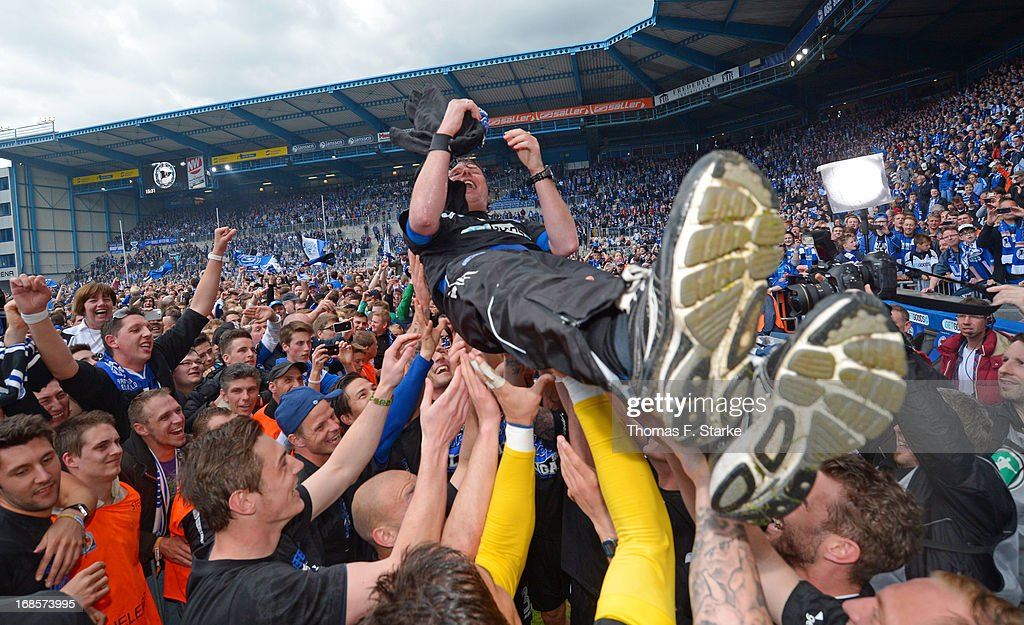 Players of Bielefeld raise their head coach Stefan Kraemer (C) after the Third League match between Arminia Bielefeld and VfL Osnabrueck at Schueco Arena on May 11, 2013 in Bielefeld, Germany.