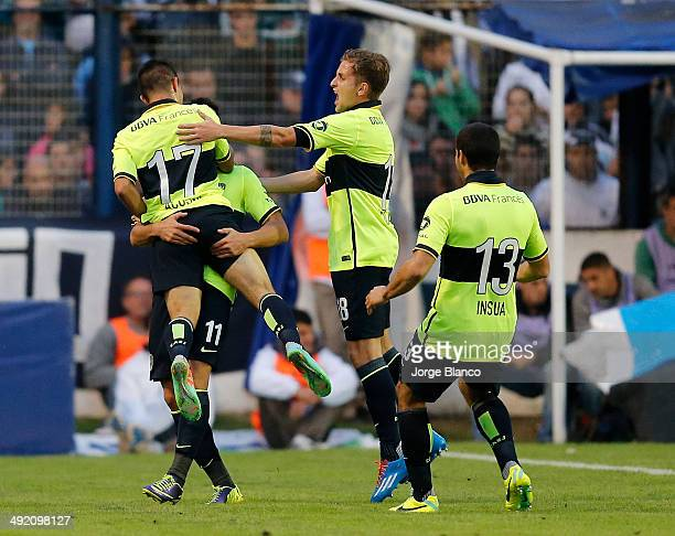 Players of Boca celebrate after score the opening goal during a match between Gimnasia and Boca as part of the 19th round of the Torneo Final 2014 on...