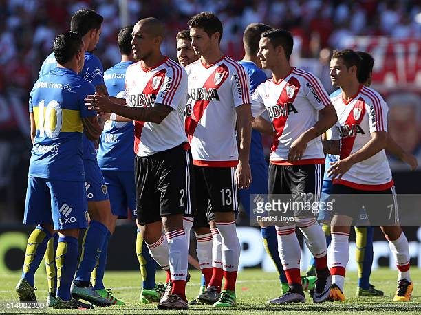 Players of Boca Juniors and River Plate great each other during a match between River Plate and Boca Juniors as part of sixth round of Torneo...