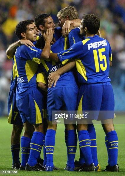 Players of Boca Juniors Carlos Tevez Diego Cagna Martin Palermo and Jose Calvo congratulate teammate Neri Cardozo after he scored the fourth goal...