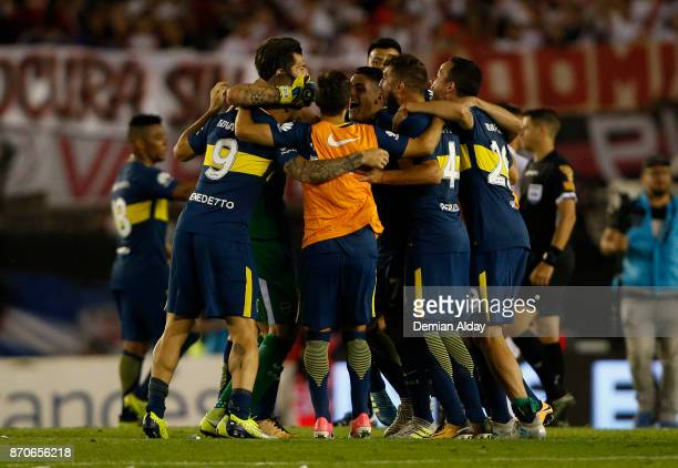 Players of Boca Juniors celebrate after winning a match between River Plate and Boca Juniors as part of the Superliga 2017/18 at Monumental Stadium...