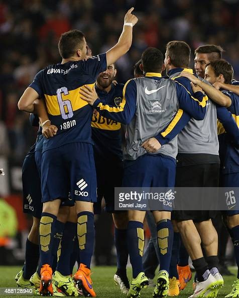 Players of Boca Juniors celebrate at the end of a match between River Plate and Boca Juniors as part of 24th round of Torneo Primera Division 2015 at...