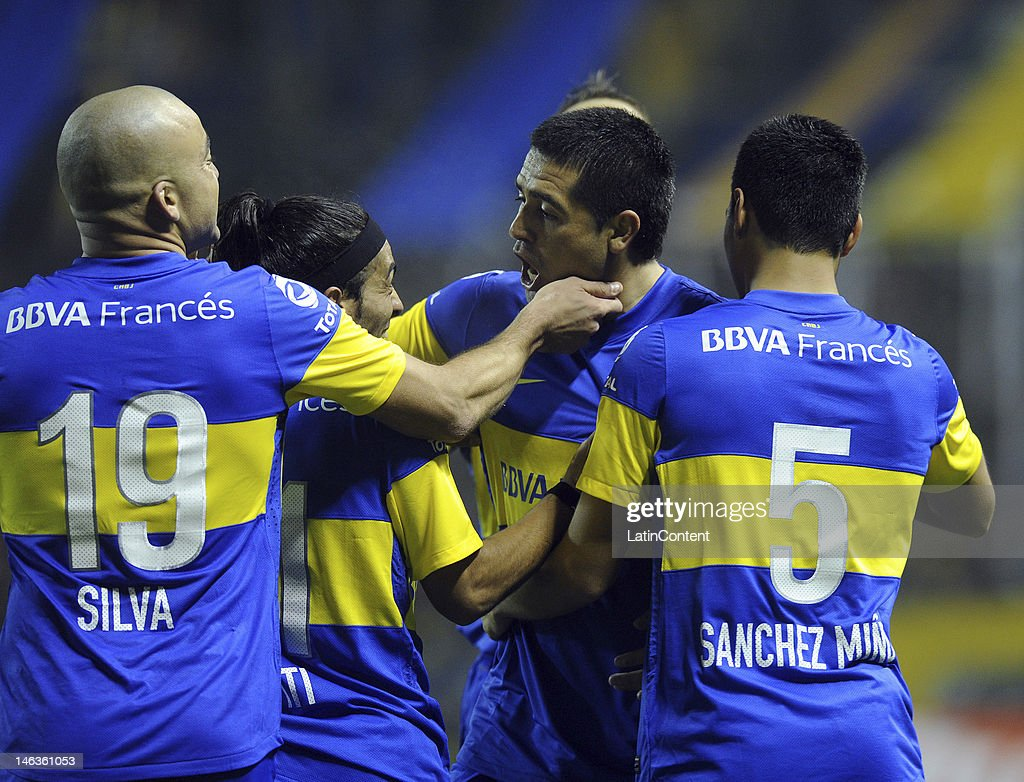 Players of Boca Juniors celebrate the second goal, scores by Juan Sanchez Miño, during the first leg of the Copa Libertadores 2012 semi-finals between Boca Jrs and Universidad de Chile at Bombonera Stadium on June 14, 2012 in Buenos Aires, Argentina.