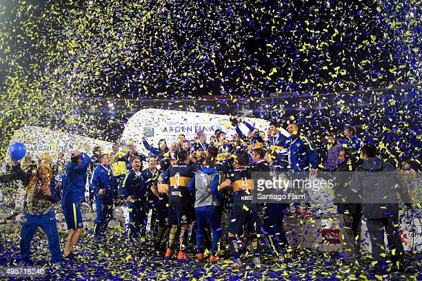 Players of Boca Juniors celebrate with the trophy after winning a final match between Boca Juniors and Rosario Central as part of Copa Argentina 2015...