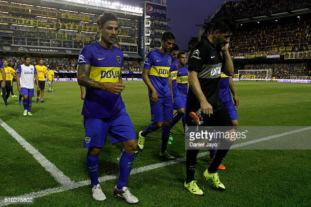 Players of Boca Juniors leave the field at the end of the first half during a match between Boca Juniors and Atletico Tucuman as part of second round...