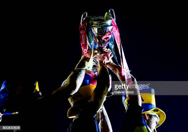 Players of Boca Juniors lift the champions trophy to celebrate after a match between Boca Juniors and Union as part of Torneo Primera Division...
