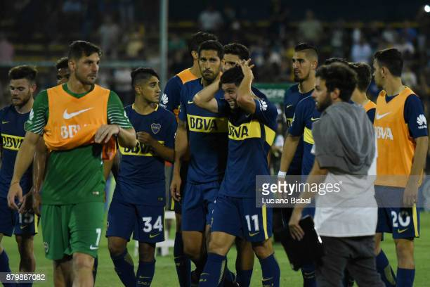 Players of Boca Juniors look dejected after a match between Rosario Central and Boca Juniors as part of the Superliga 2017/18 at Estadio Gigante de...