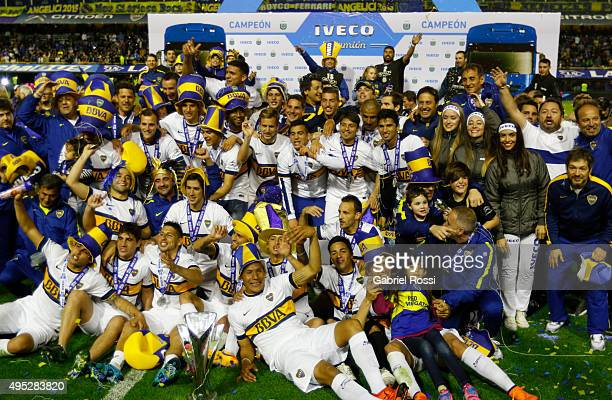Players of Boca Juniors pose for a group photo after winning the local soccer tournament after a match between Boca Juniors and Tigre as part of 29th...