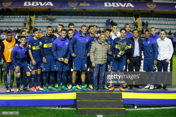 Players of Boca Juniors pose with the trophy after the international friendly match between Boca Juniors and Villarreal CF at Alberto J Armando...
