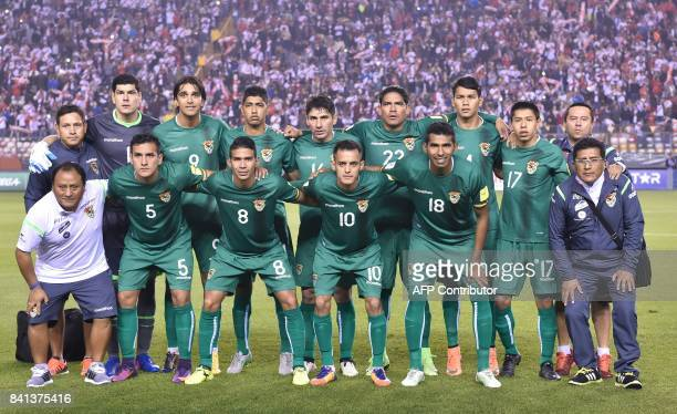 Players of Bolivia pose for pictures before the start of the 2018 World Cup football qualifier match against Peru in Lima on August 31 2017...