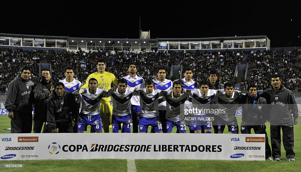 Players of Bolivia's San Jose pose before their Copa Libertadores football match against of Colombia Millonarios at Jesus Bermudez stadium in Oruro, Bolivia, on March 14, 2013.AFP PHOTO/Aizar Raldes