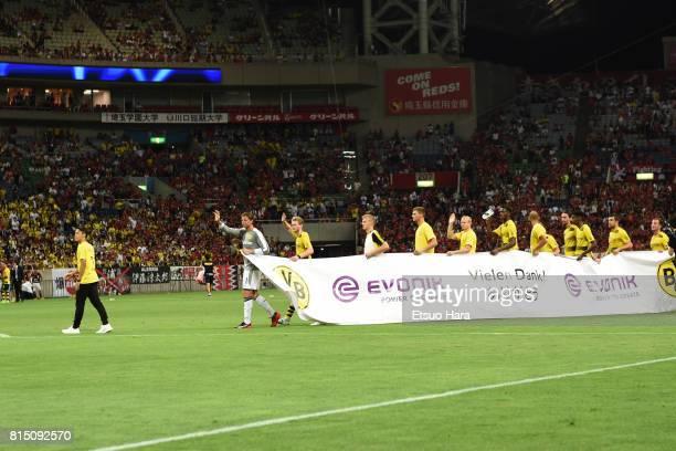 Players of Borussia Dortmund applaud fans after the preseason friendly match between Urawa Red Diamonds and Borussia Dortmund at Saitama Stadium on...