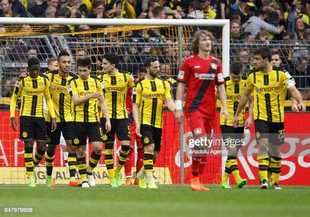 Players of Borussia Dortmund celebrate after scoring a goal during the Bundesliga soccer match between Borussia Dortmund and Bayer 04 Leverkusen at...
