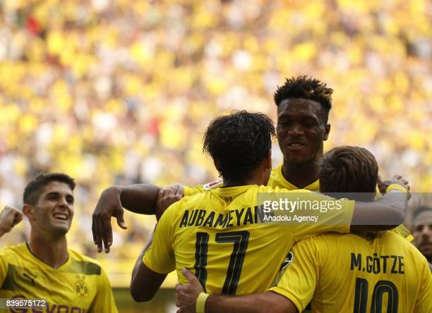 Players of Borussia Dortmund celebrate after scoring a goal during the Bundesliga soccer match between Borussia Dortmund and Hertha BSC Berlin at the...