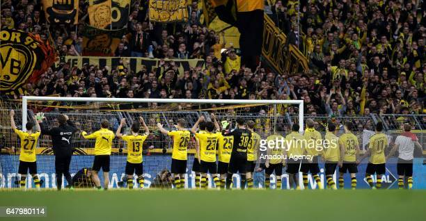 Players of Borussia Dortmund celebrate after the Bundesliga soccer match between Borussia Dortmund and Bayer 04 Leverkusen at the Signal Iduna Park...
