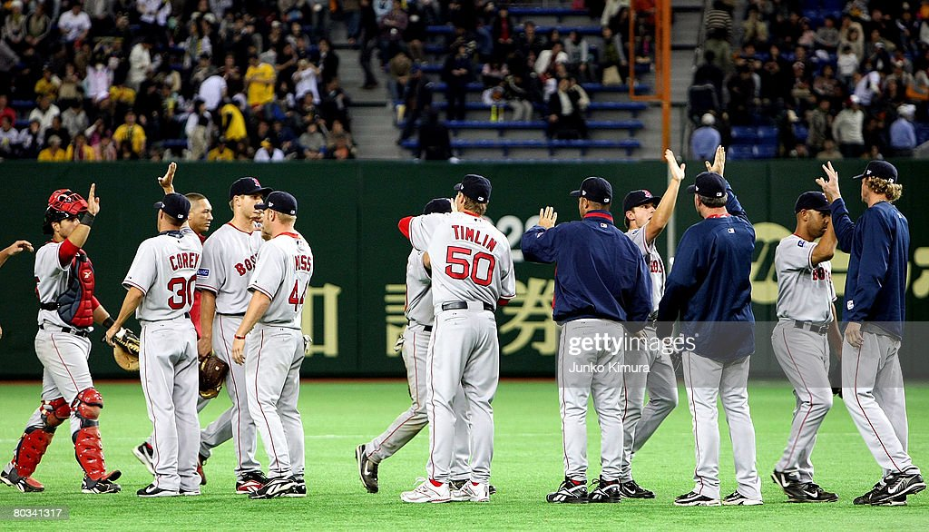 Players of Boston Red Sox celebrate after winning the preseason friendly between Boston Red Sox and Hanshin Tigers at Tokyo Dome on March 22, 2008 in Tokyo, Japan.