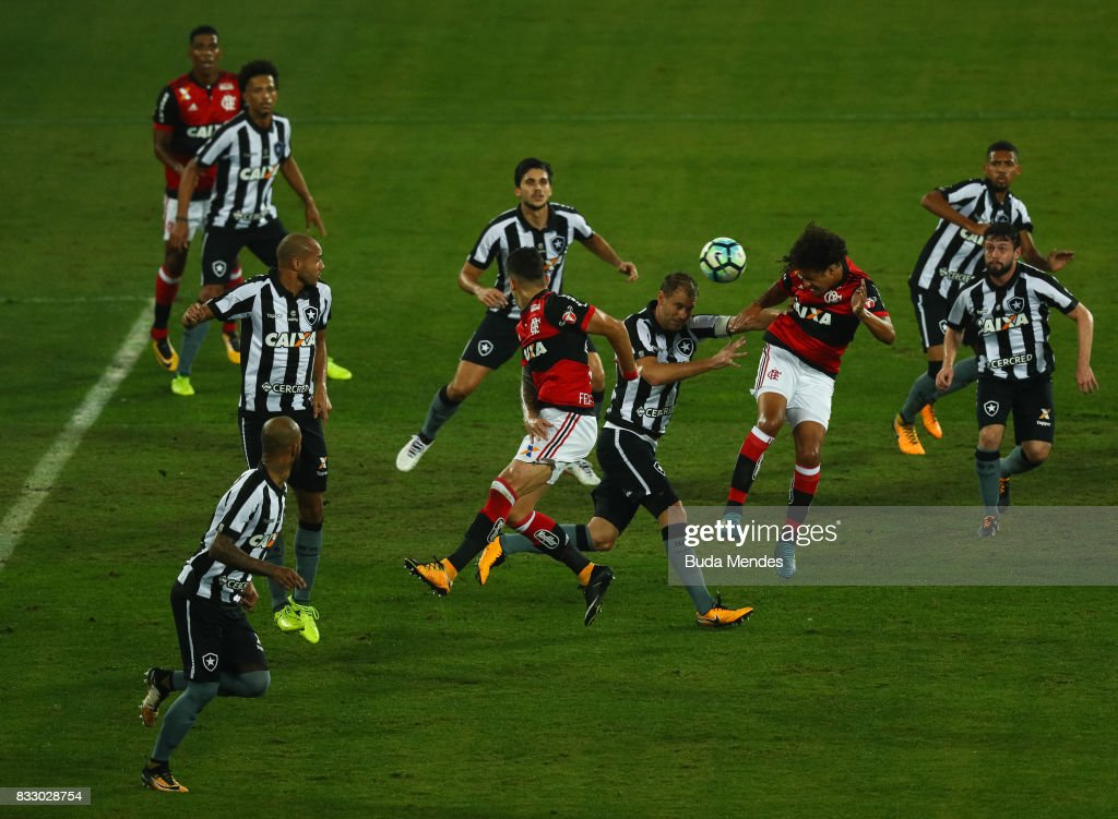Players of Botafogo and Flamengo fight to the ball during a match between Botafogo and Flamengo as part of Copa do Brasil Semifinals 2017 at Nilton Santos Olympic Stadium on August 16, 2017 in Rio de Janeiro, Brazil.