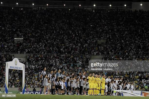Players of Botafogo and Vasco da Gama listen the national anthem before the match between Vasco da Gama and Botafogo as part of Brasileirao Series A...