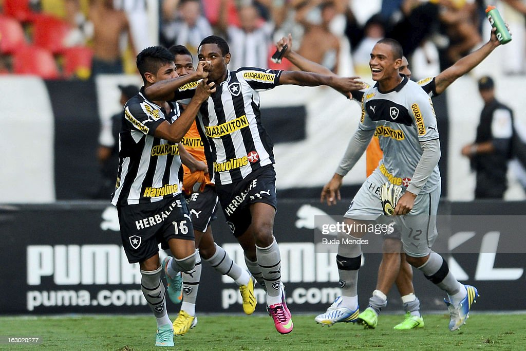 Players of Botafogo celebrate a goal against Flamengo during the match between Botafogo and Flamengo as part of Carioca Championship 2013 at Engenhao Stadium on March 03, 2013 in Rio de Janeiro, Brazil.