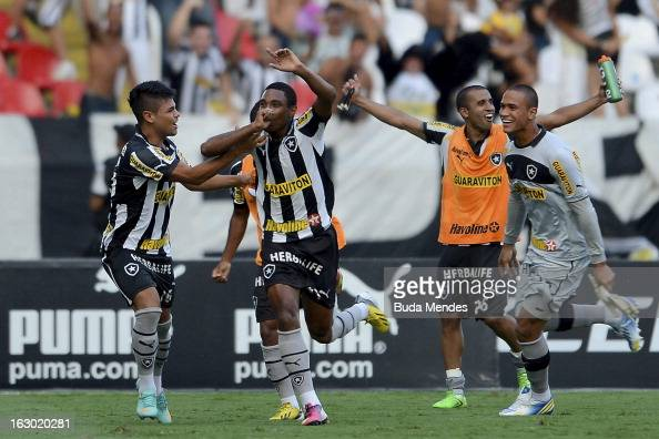 Players of Botafogo celebrate a goal against Flamengo during the match between Botafogo and Flamengo as part of Carioca Championship 2013 at Engenhao...
