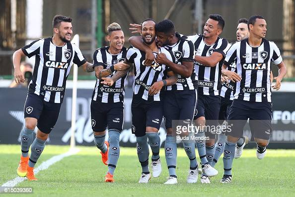 Players of Botafogo celebrate a scored goal against Atletico Mineiro during a match between Botafogo and Atletico Mineiro as part of Brasileirao...