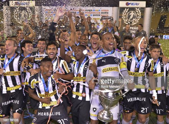 Players of Botafogo celebrate after winning the Rio State Championship 2013 at Raulino de Oliveira Stadium on May 05 2013 in Volta Redonda Brazil