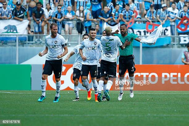 Players of Botafogo celebrate their first goal during the match Gremio v Botafogo as part of Brasileirao Series A 2016 at Arena do Gremio on December...