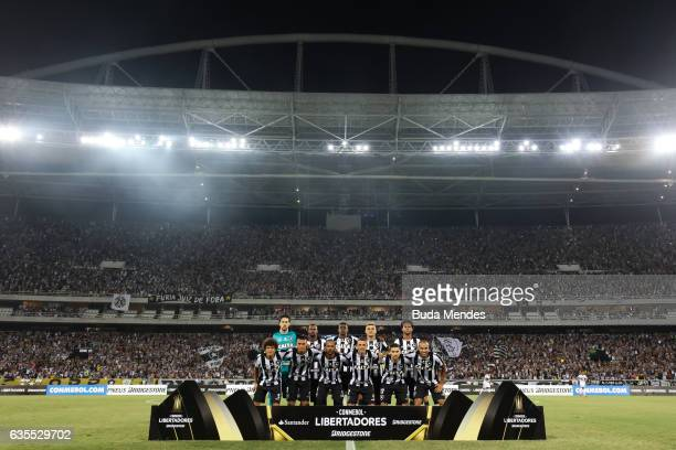 Players of Botafogo pose for photo before a match between Botafogo and Olimpia as part of Copa Bridgestone Libertadores at Engenhao Stadium on...