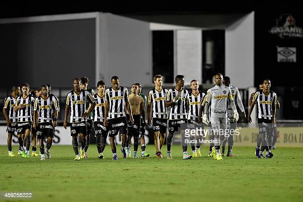 Players of Botafogo walk after a match between Botafogo and Figueirense as part of Brasileirao Series A 2014 at Sao Januario Stadium on November 19...
