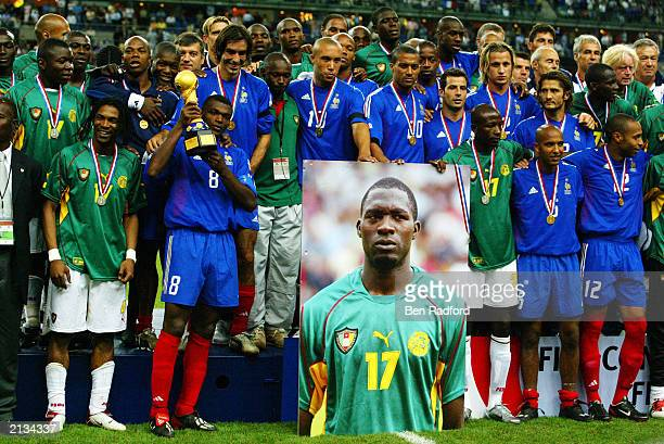 Players of both Cameroon and France stand together to help celebrate the life of MarcVivien Foe who tragically died in the semifinal after the FIFA...