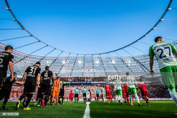 Players of both teams enter the pitch prior to the Bundesliga match between Bayer 04 Leverkusen and VfL Wolfsburg at BayArena on October 15 2017 in...