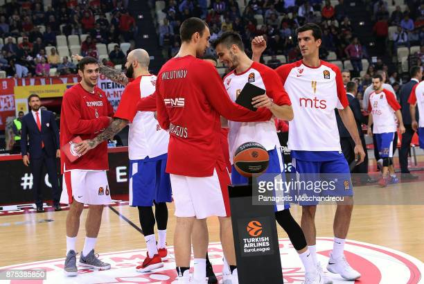 Players of both teams exchange handshakes before the 2017/2018 Turkish Airlines EuroLeague Regular Season Round 8 game between Olympiacos Piraeus and...
