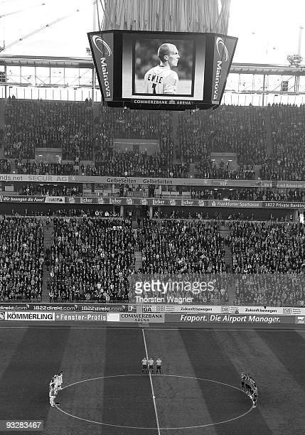 Players of both teams stand up for a minute of silence in remembrance of Robert Enke in prior to the during the Bundesliga match between Eintracht...