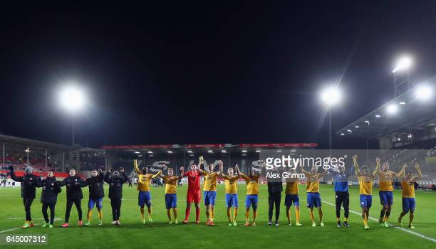 Players of Braunschweig celebrate with the fans after the Second Bundesliga match between SV Sandhausen and Eintracht Braunschweig at...