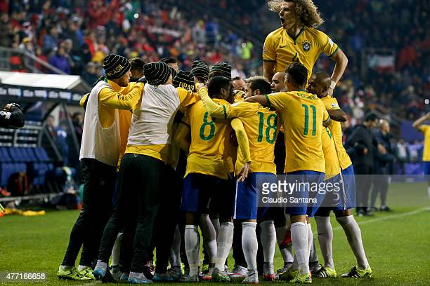 Players of Brazil celebrate a goal scored by their teammate Douglas Costa during the 2015 Copa America Chile Group C match between Brazil and Peru at...