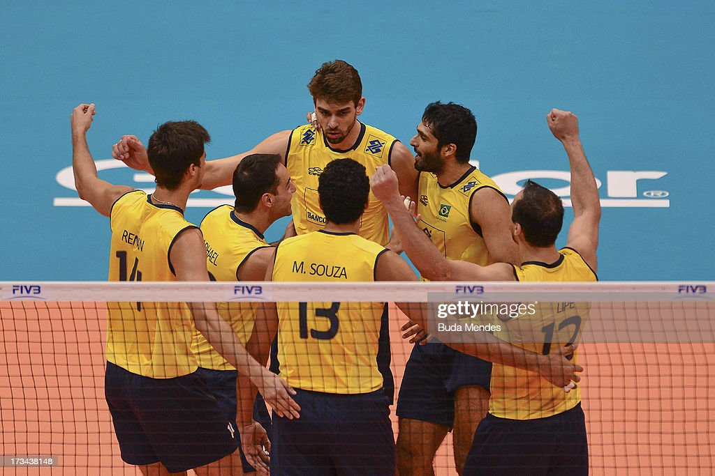 Players of Brazil celebrate a point against USA during a match between Brazil and USA as part of the FIVB Volleyball World League 2013 at the Maracanazinho gymnasium on July 14, 2013 in Rio de Janeiro, Brazil.