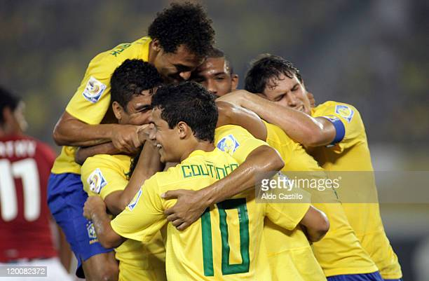 Players of Brazil celebrate a scored goal against Egypt during a match as part of group E of Sub20 World Cup 2011 at Metropolitano Stadium on July 29...