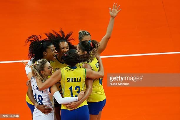 Players of Brazil celebrate after a point during the match against Italy on day 1 the FIVB Volleyball World Grand Prix at Carioca Arena 1 on June 9...