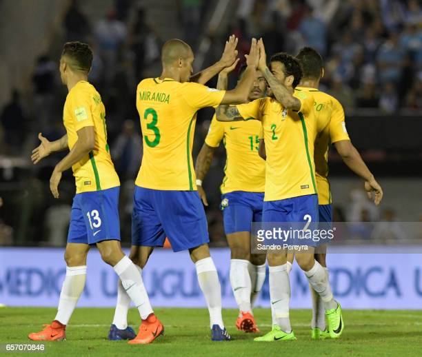 Players of Brazil celebrate after winning a match between Uruguay and Brazil as part of FIFA 2018 World Cup Qualifiers at Centenario Stadium on March...