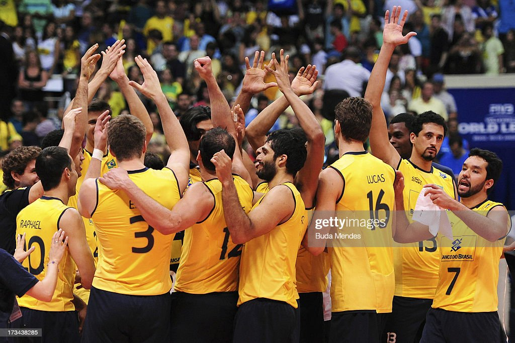 Players of Brazil celebrate the victory after a match between Brazil and USA as part of the FIVB Volleyball World League 2013 at the Maracanazinho gymnasium on July 14, 2013 in Rio de Janeiro, Brazil.