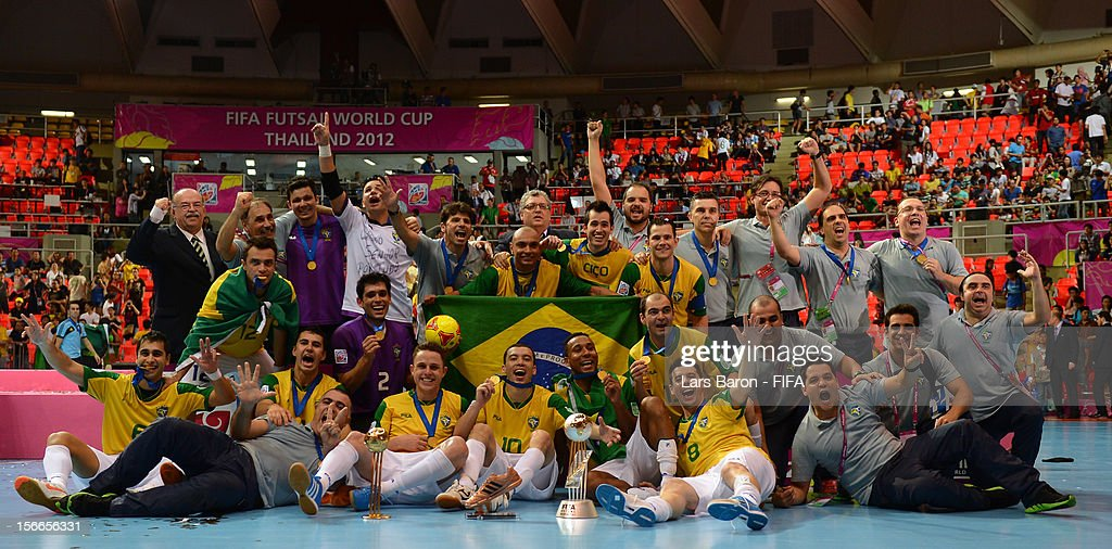 Players of Brazil celebrate with the trophy after winning the FIFA Futsal World Cup Final at Indoor Stadium Huamark on November 18, 2012 in Bangkok, Thailand.