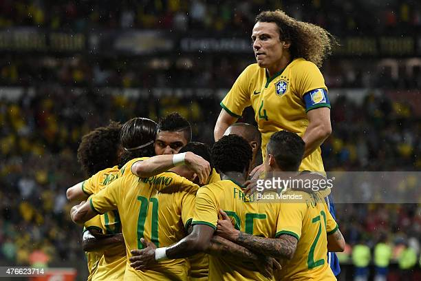 Players of Brazil celebrates after scoring a goal during the International Friendly Match between Brazil and Honduras at Beira Rio Stadium on June 10...