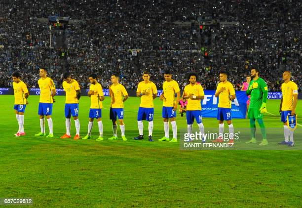Players of Brazil listen to the national anthem before the start of their 2018 FIFA World Cup qualifier football match against Uruguay at the...
