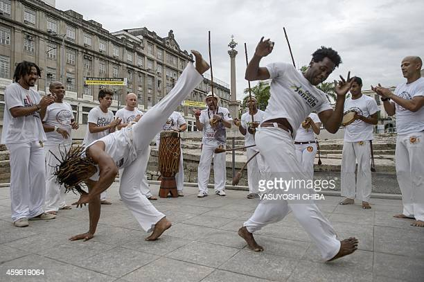 Players of Brazilian Capoeira a mixture of dance and martial art inherited from the times of slavery perform to celebrate the nomination of Capoeira...