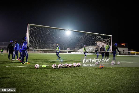 Players of Brazilian football club Fluminense FC and Slovakian football club FC STK Samorin carry a goal during a training session in Samorin...