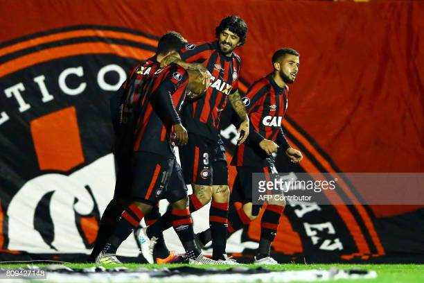 Players of Brazil's Atletico Paranaense celebrate after scoring against Brazil's Santos during their 2017 Libertadores Cup football match at the Vila...